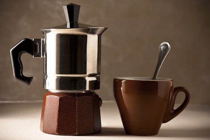 Brown Moka pot and coffee cup